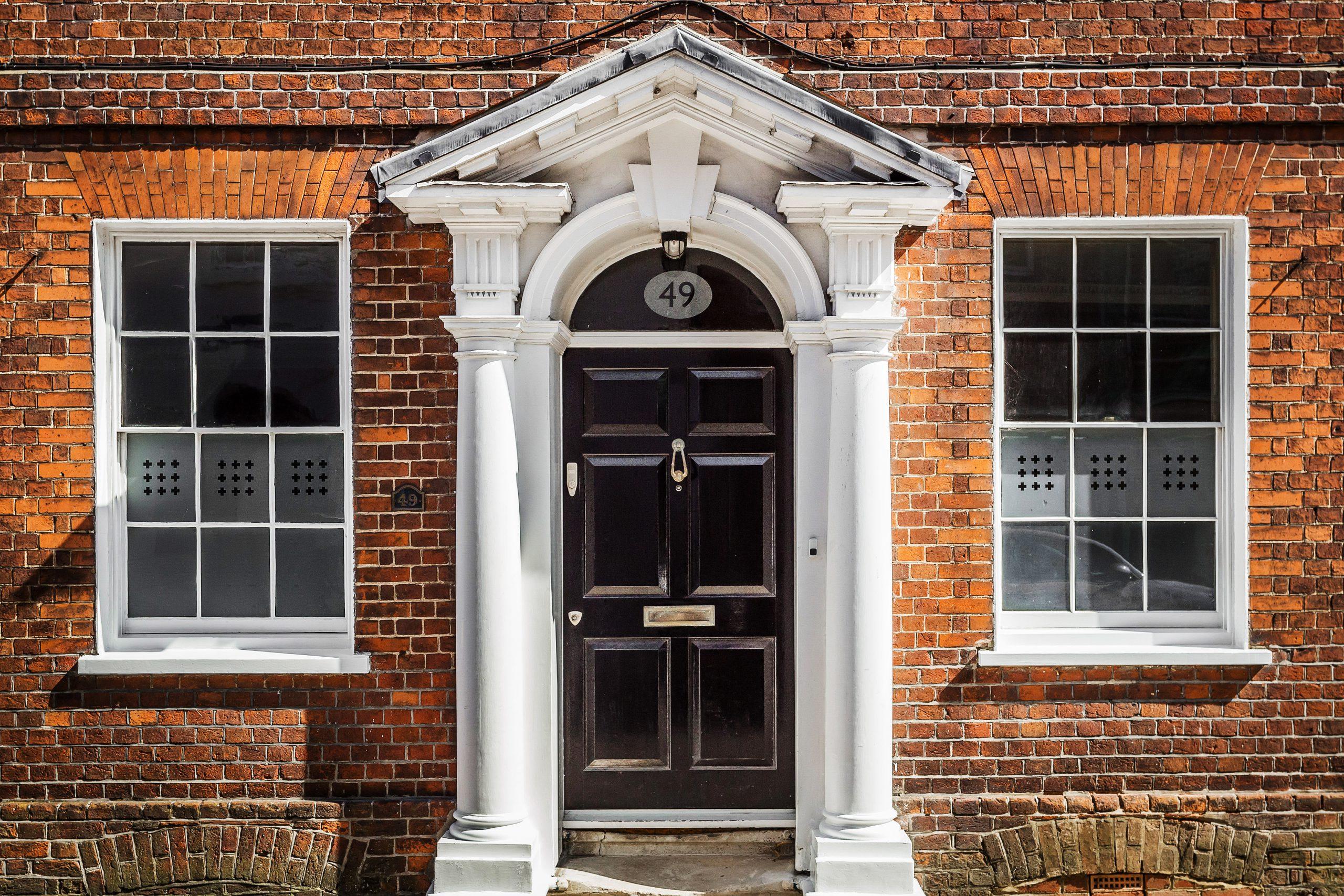 House with Black Door and Pillars